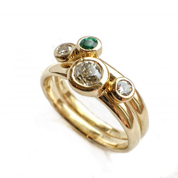 Diamond, emerald and gold stacking rings