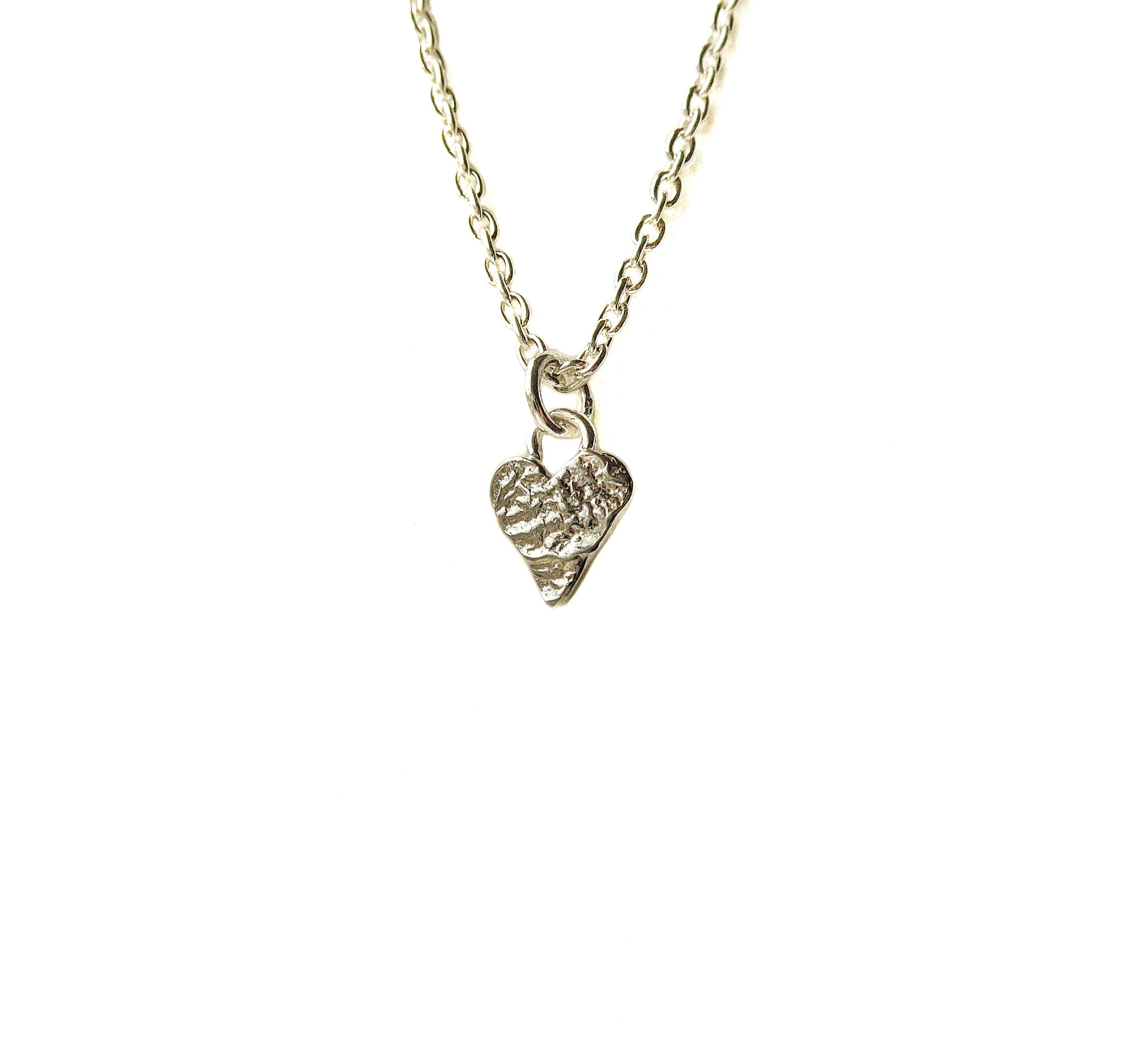 a46bb15858294 Handmade petite silver textured heart pendant