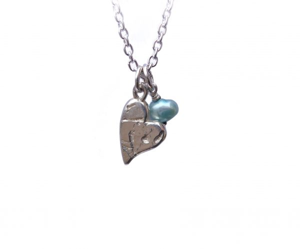 Handcrafted silver heart pendant with an Italian blue fresh water pearl