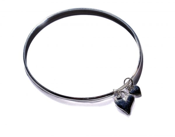 Silver bangle with two hearts.