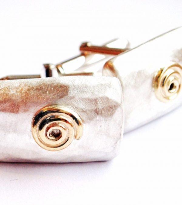 cufflinks with gold spiral