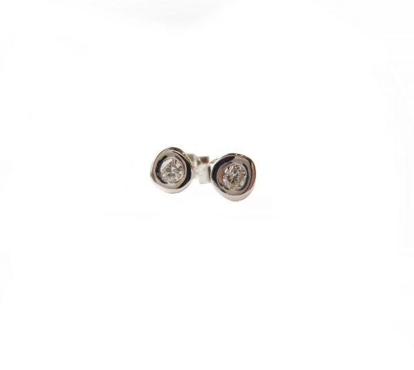 Diamond stud earrings set in white gold.