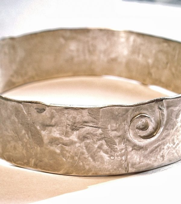 Hand beaten silver bangle