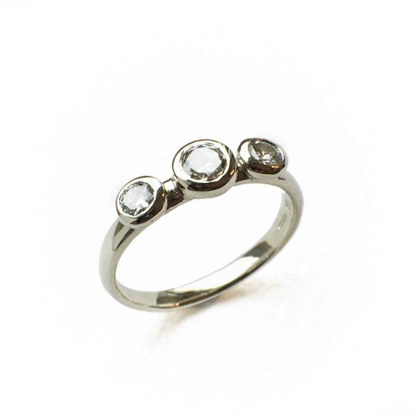 Handmade gold ring with three diamonds