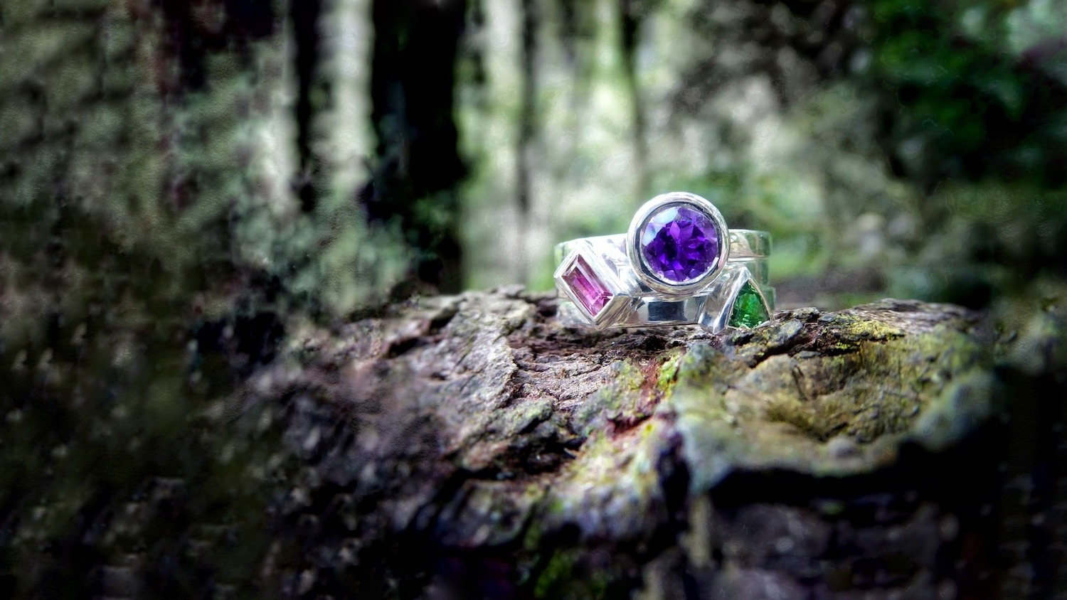 Three stacking rings set with amethyst, tsavorite and pink tourmaline.