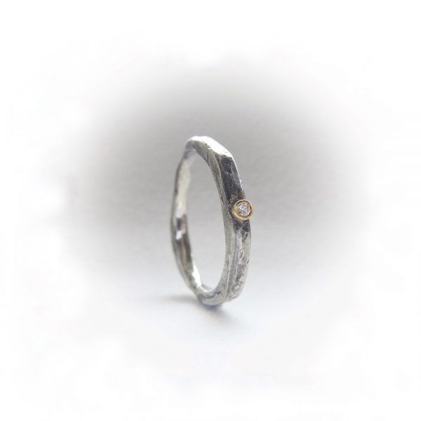 Contemporary silver ring set with diamond.