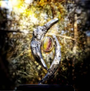 Mystical sculpture with engraving 'What are you looking for'